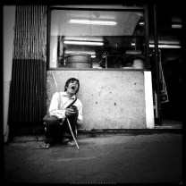 A blind beggar sings loudly along the Session Road in Baguio City. (captured using iPhone 4s).