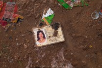 LOST IDENTITY | A postal ID is seen laying in the wet grounds of a dumpsite in Irisan, Baguio City.