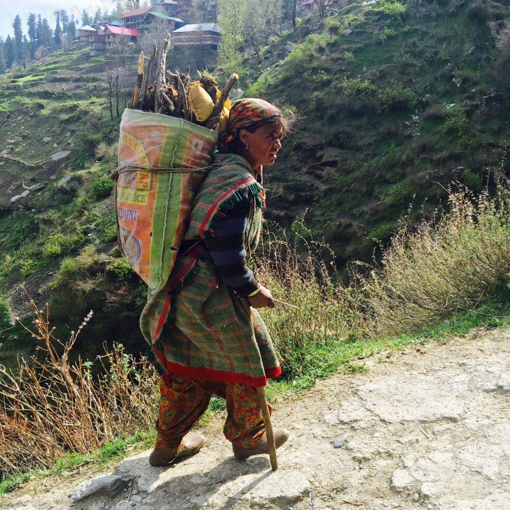 Malanese woman carrying firewood