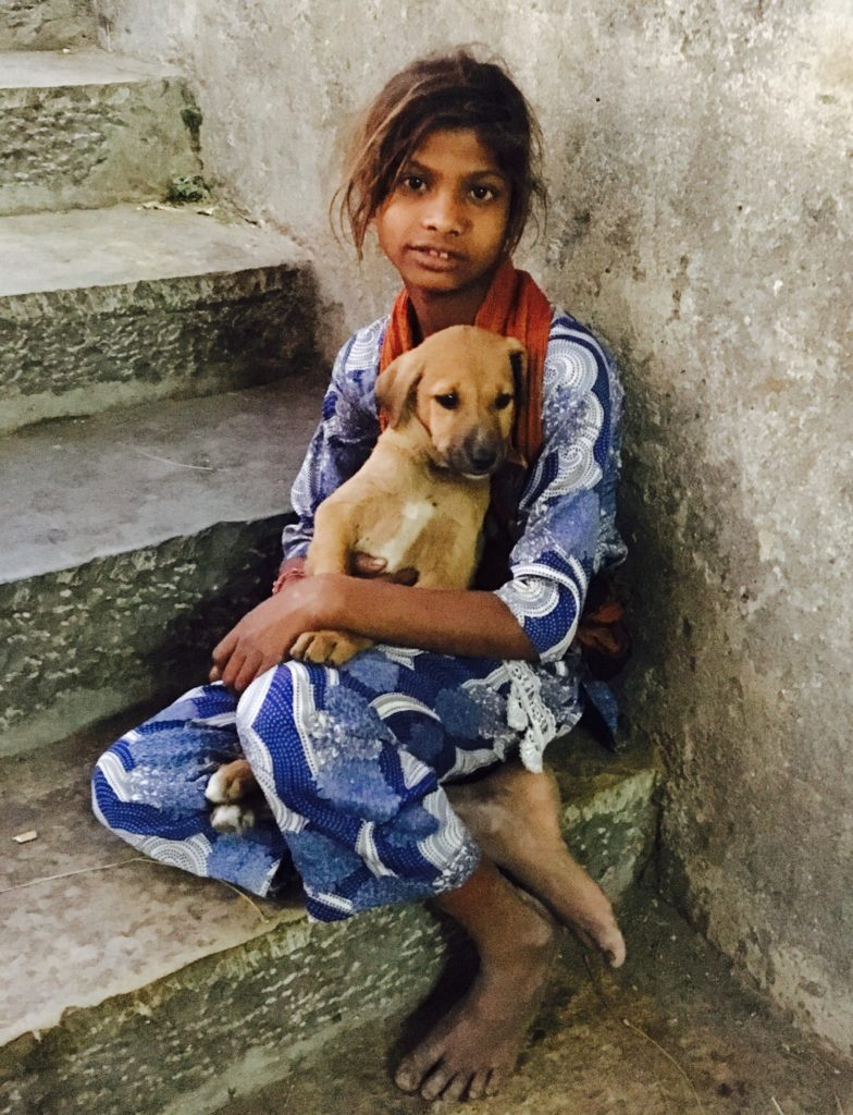 Little girl and her puppy in Udaipur, India