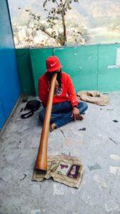 Indian man playing the didgeridoo
