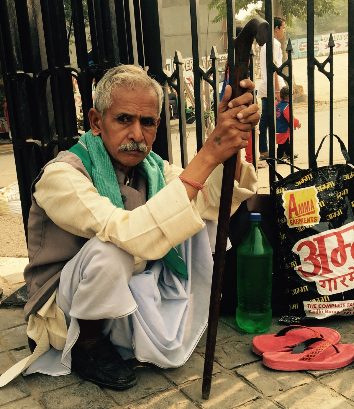 Indian man in Delhi passing the time
