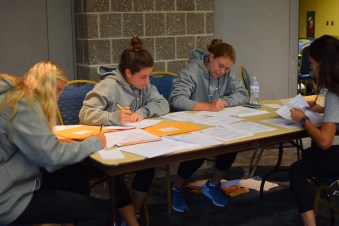 Some of Villanova University's women's field hockey team writng letters to Philadlephia area schools suggesting a sock drive for the homeless as a school community service project.
