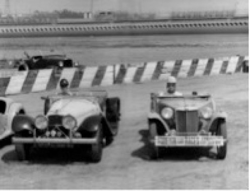 Phil Hill (right) in his MGTC at Carrell Speedway on July 24, 1949