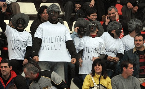 Spanish fans taunt and abuse Hamilton at the Barcelona test, in February, 2008