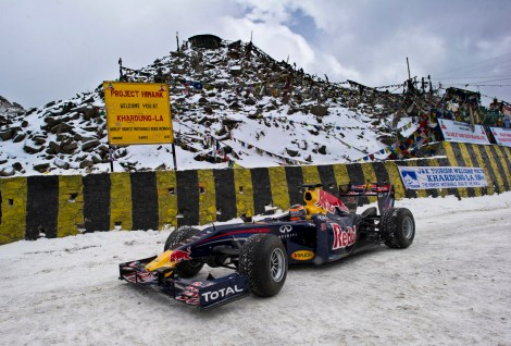 Red Bull Racing driver Neel Jani drives the Formula One show car on the world's highest motorable road at 18,380 feet on the Khardung-La pass in Leh region in India on October 10, 2011.