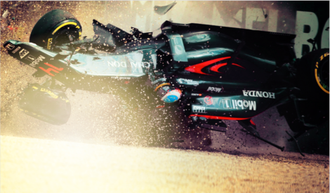 alonso rolls across the gravel at high speed during the australian grand prix 2016