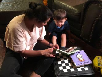 When Alyssa not listening to books with existential life questions, she enjoys reading potty and animal books with her nephew, Max.
