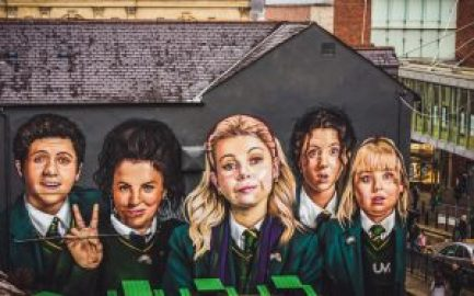 Derry Girls mural painted on wall in Londonderry, Northern Ireland