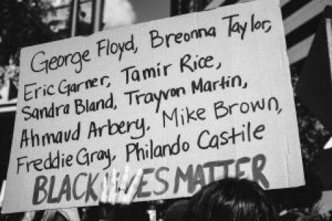 "Poster saying ""George Floyd, Breonna Taylor, Eric Garner, Tamir Rice, Sandra Bland, Trayvon Martin, Ahmaud Arbery, Mike Brown, Freddie Gray, Philando Castile, BLACK LIVES MATTER"""