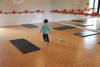 One of the kids being babysat was put to work cleaning the studio after class ended!