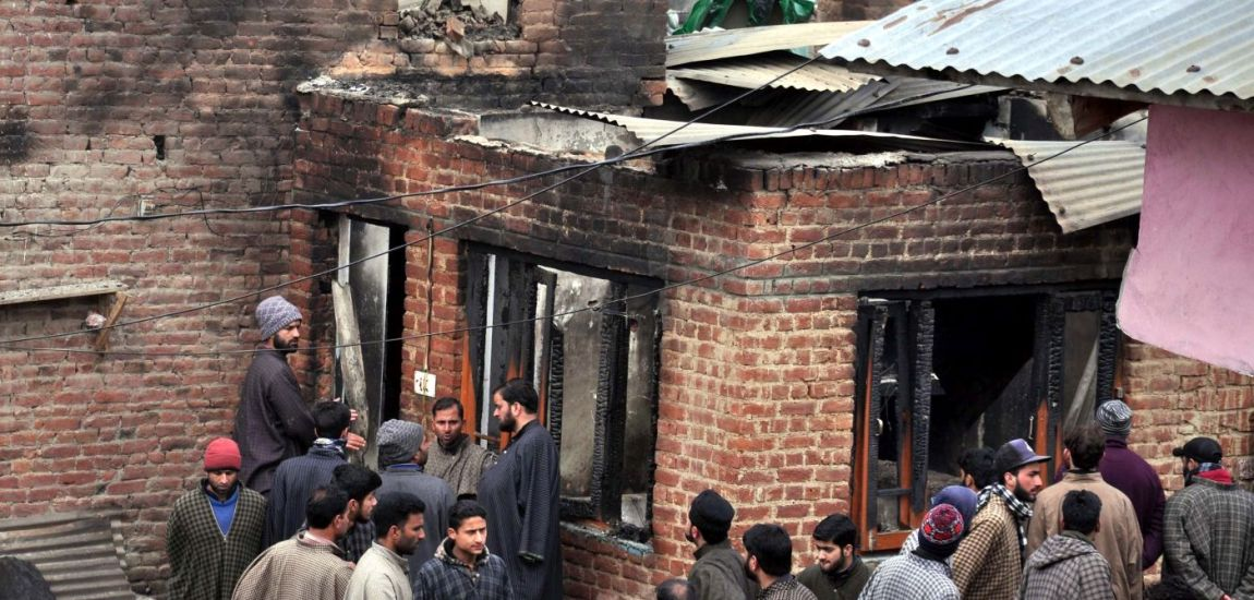 Locals throng the residential houses, damaged in Monday's encounter…