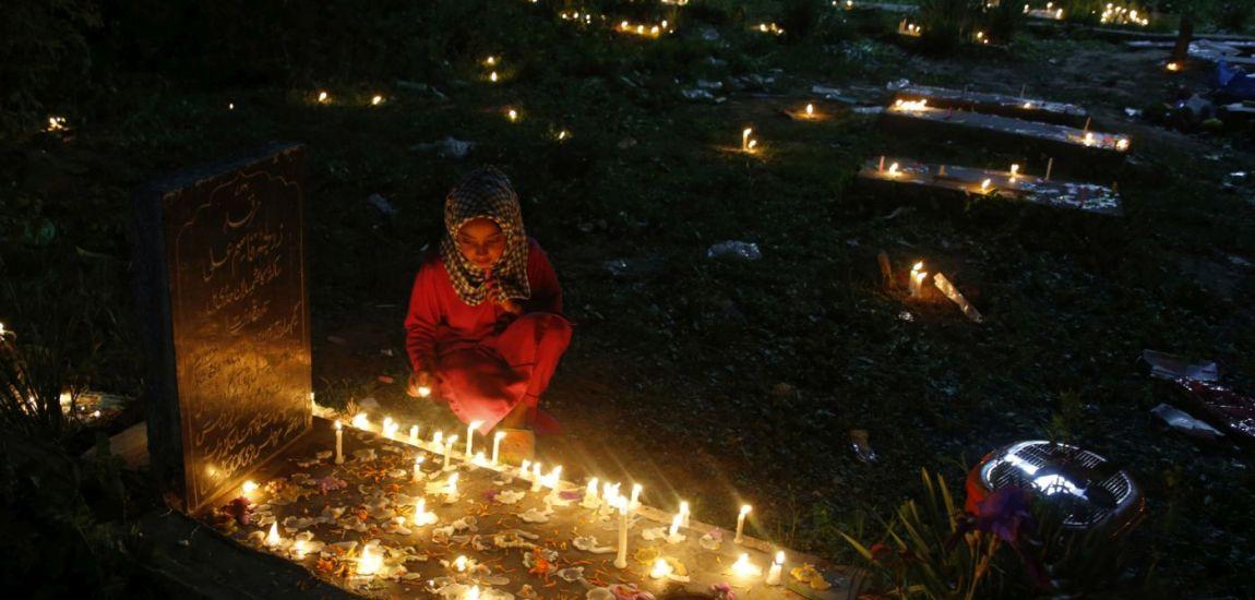 A child lit candles on the grave of her mother in a Srinagar graveyard on the auspicious …