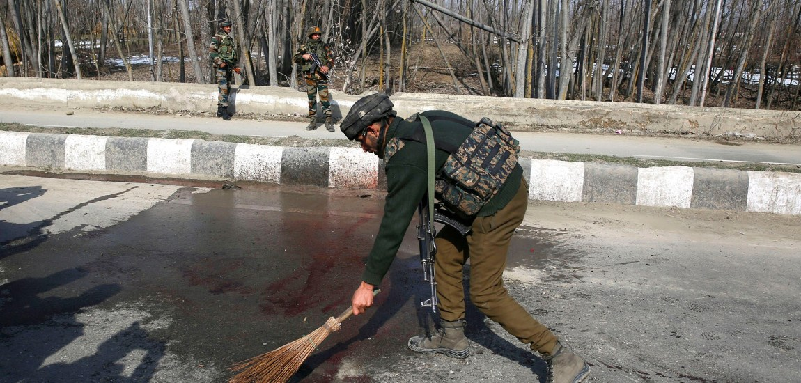 A policeman washes the blood stains from the encounter site…
