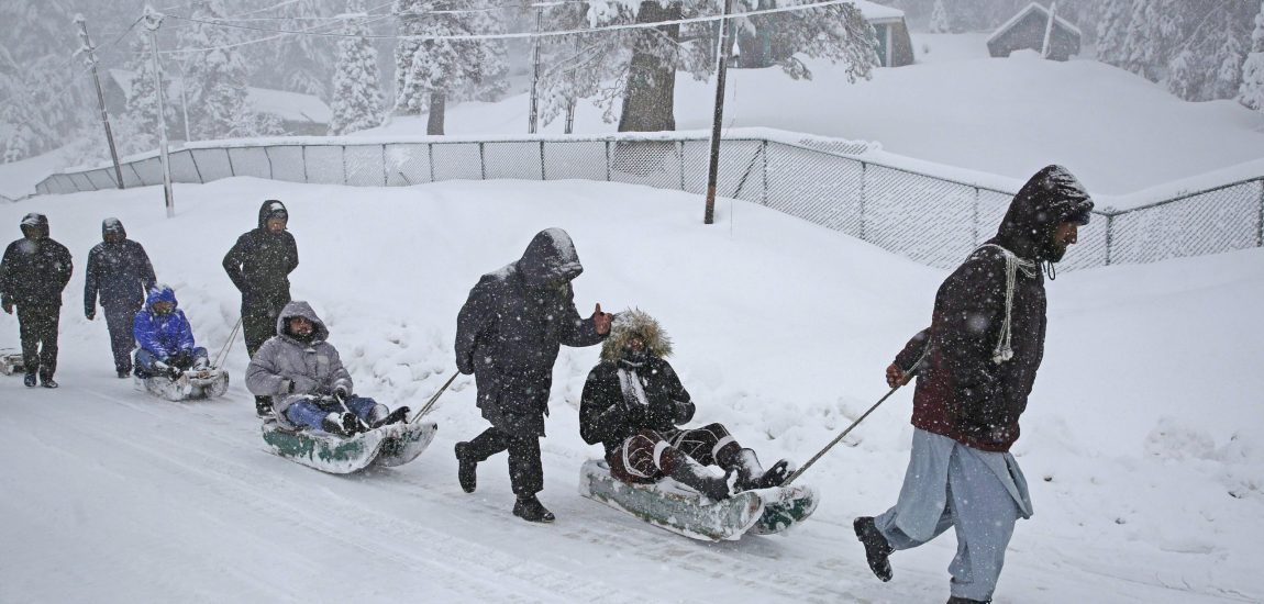 Tourists enjoy a sledge ride in Gulmarg…