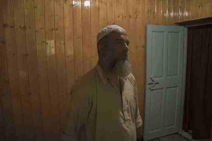 Muzaffer Ahmad Wani, fathre of Burhan Wani, who works in the education department. Photograph by Vikar Syed