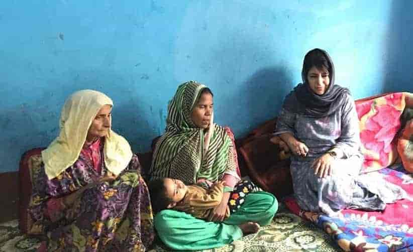 Mehbooba Mufti with the mother of 9-year-old girl who was raped and killed in Boniyar area of Uri in North Kashmir. Photograph by JKPDP Twitter