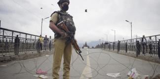A paramilitary forces' personnel guarding Amira Kadal bridge in Srinagar. Photograph by Sanna Irshad Mattoo