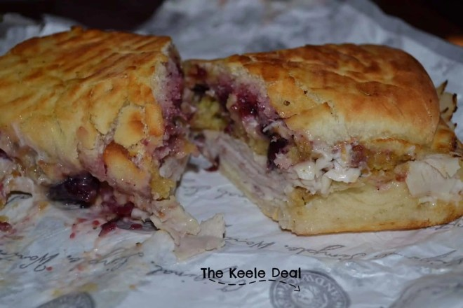 The Holiday Turkey Sandwich is like Thanksgiving all in one bite. It's amazing! Definitely a must on your next Disney Trip. thekeeledeal.com #Disney #food #travel