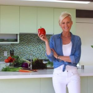 Kellie with a red pepper