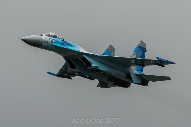 Aviation related image of a blue Ukrainian SU-27 Flanker taken at an airshow. A fact about me
