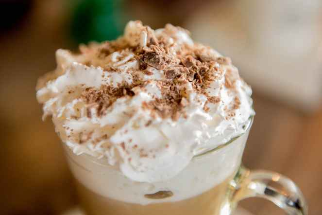 coffee latte with cream and sprinkles