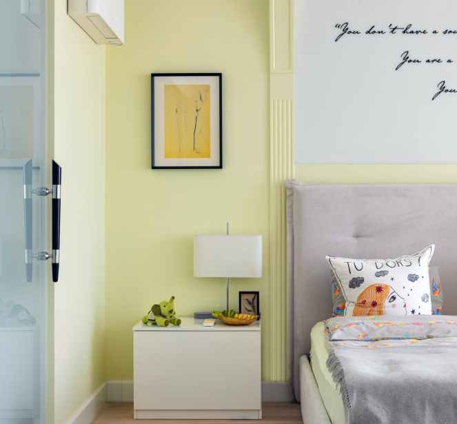 cozy bedroom with modern interior and picture on wall after declutter & organisation.
