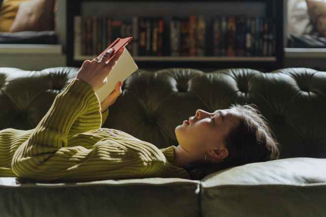 woman in yellow long sleeve shirt lying on couch for Untamed by Glennon Doyle
