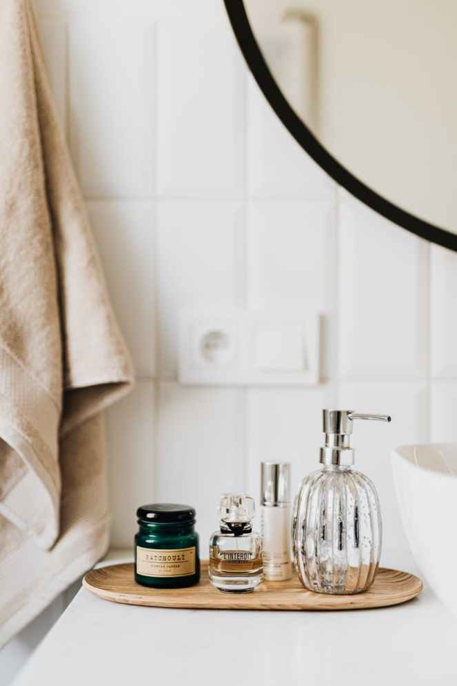 set of skincare supplies on white table in bathroom for products I've been using post.