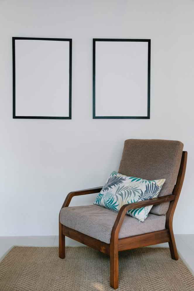 cozy armchair with pillow in light room