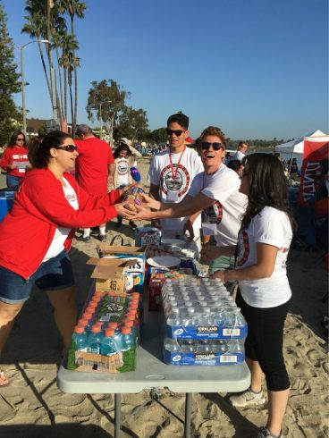 Students enjoying the breakfast food supplied by the Las Vegas YMF group at the 2016 Pacific Southwest Conference for the big concrete canoe race day!