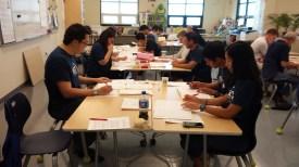Volunteers from Hawaii YMF scoring MATHCOUNTS tests