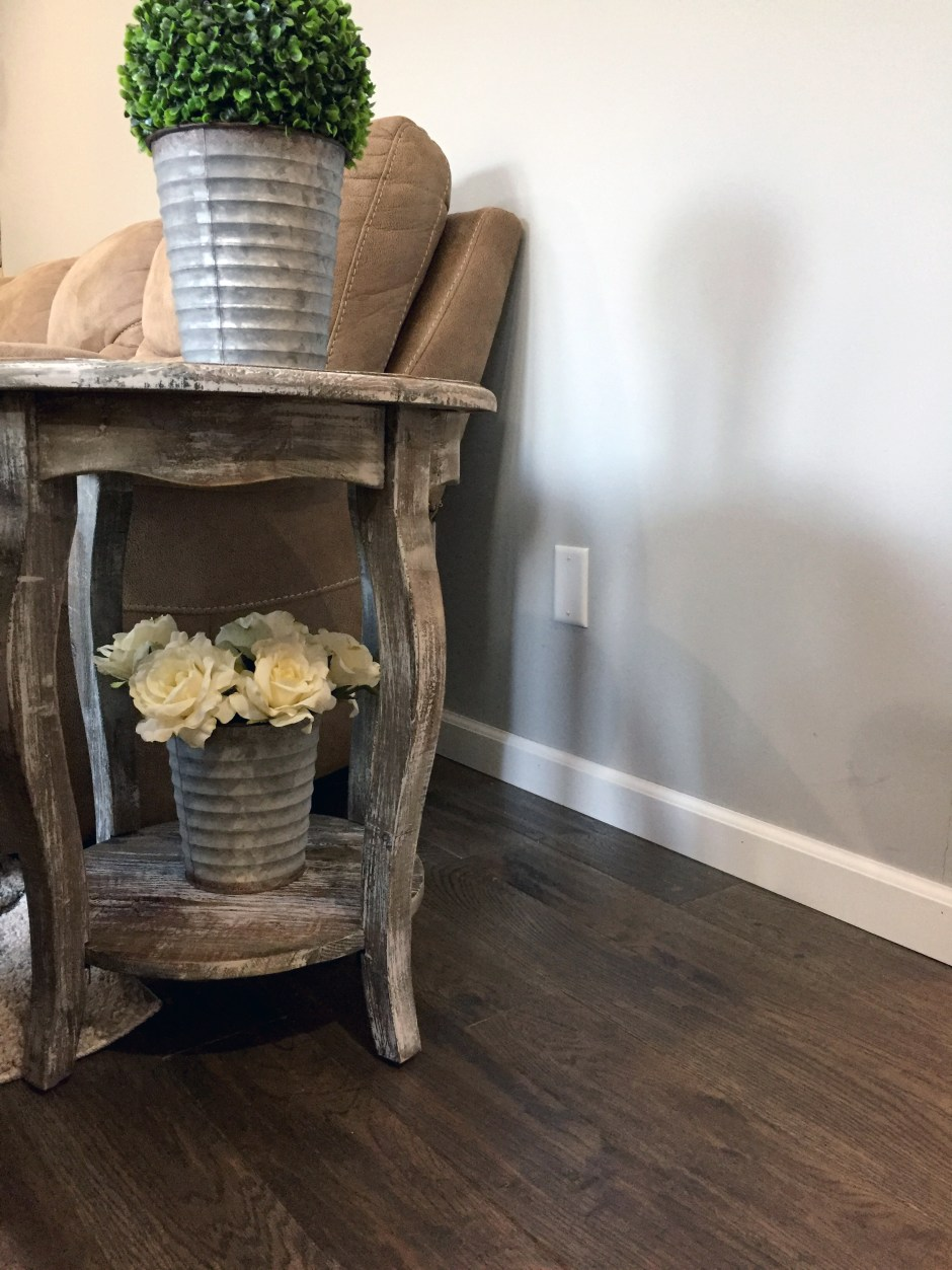 Changing room colors from warm to cool - grays, white, and black for a french country farmhouse style. DIY Shiplap ceiling, wood pallet accent wall, Sherwin Williams light french gray, Bruce american vintage wolf run oak