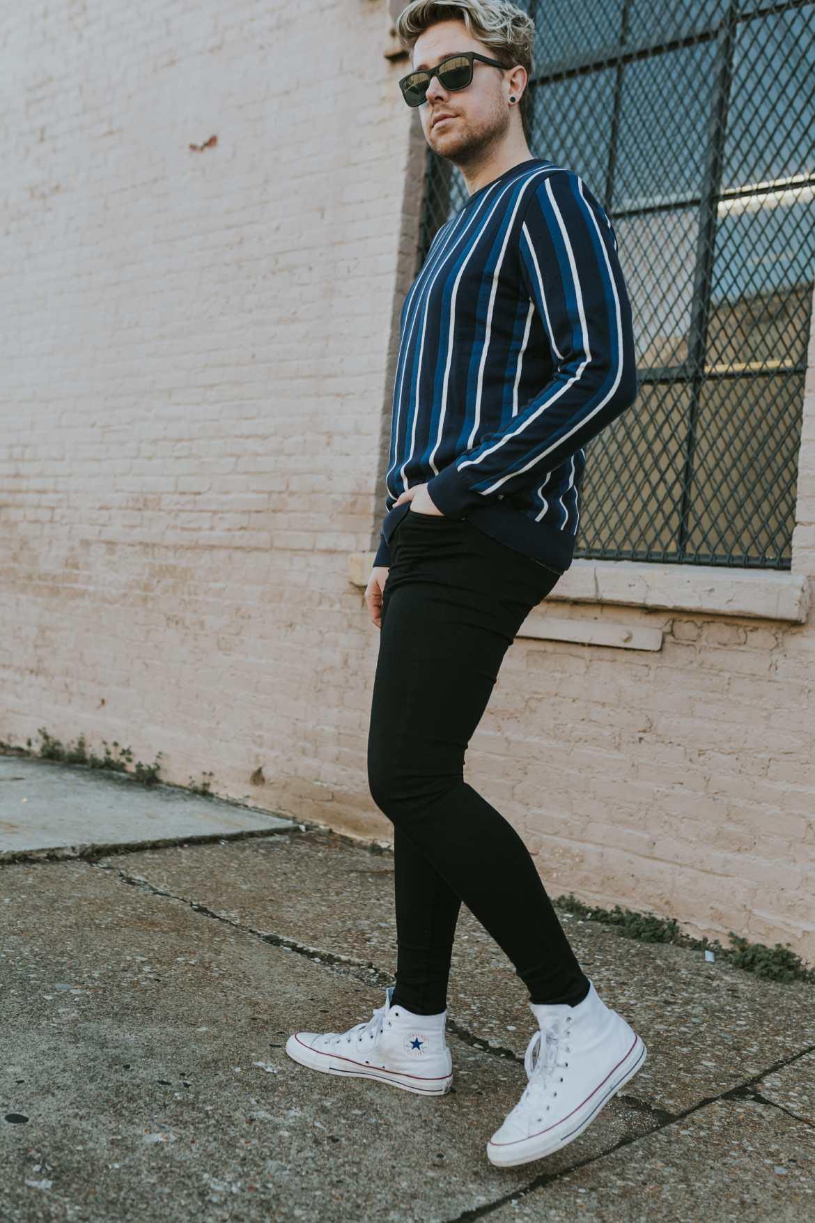 man in black jeans