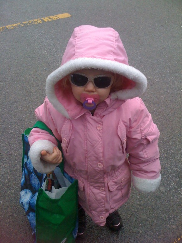 Rocking the granny look.  Shopping bag?  Check!  Sunglasses?  Check!  Bubba (Pacifier)? Check!  She's ready to own the shops.  Please, Ms. Moon.  Never lose your sense of individuality, never lose your sense of self, and never let anyone tell you that you're anything less than perfect.  Just the way you are. P.S.  This was taken in March, the pacifier and the winter coat are both distant memories now *grin*
