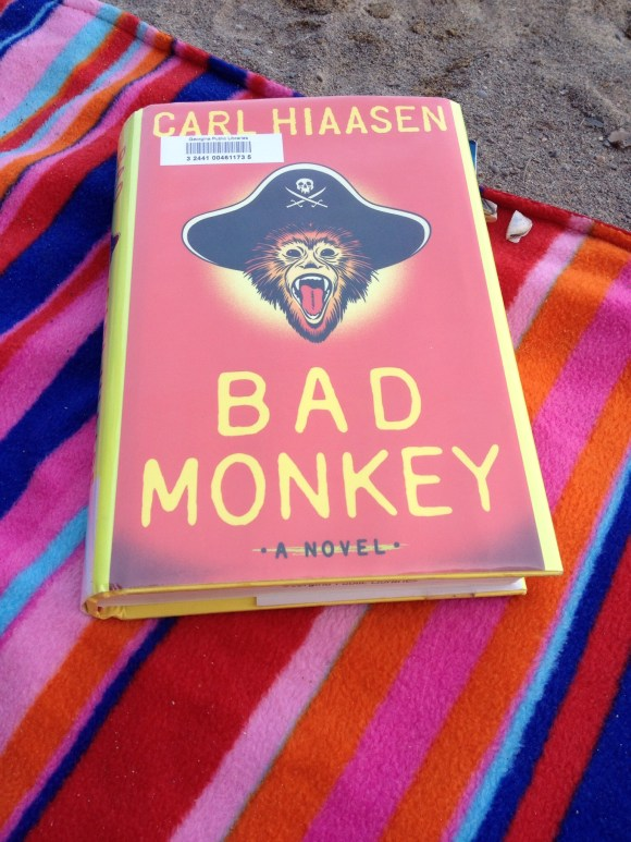 Bad Monkey at the beach. I just can't get enough of Hiaasen's writing - it just never gets old.