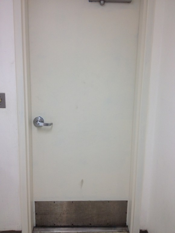 This is the inside of the door. A little dingy, perhaps more contaminated than not, but when you really have to pee, just having a door makes this space AWESOME.