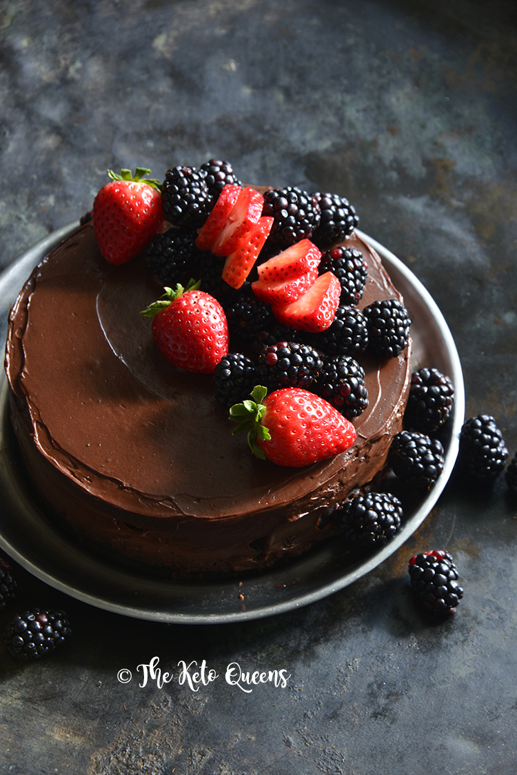 Low Carb Flourless Chocolate Cake Recipe with Fudgy Chocolate Frosting on Metal Background
