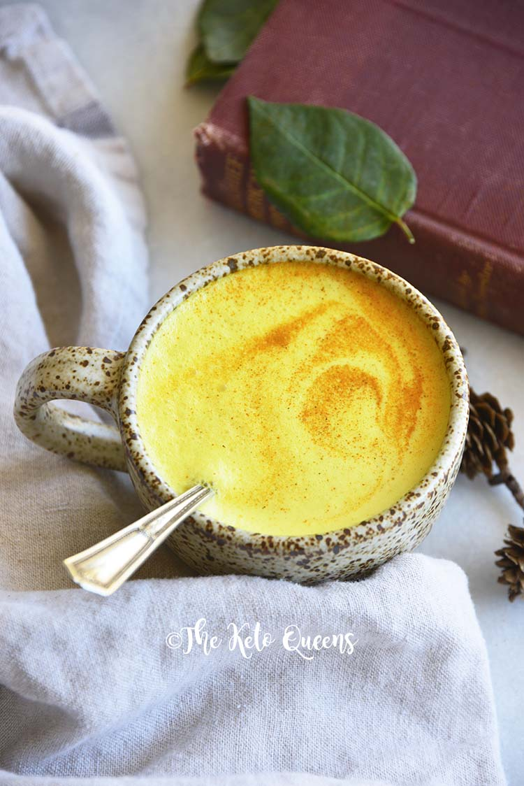 Golden Milk with Swirl of Turmeric on Foamy Top