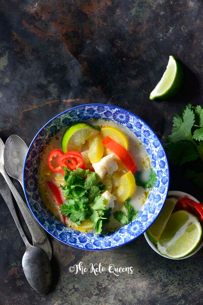 image of a bowl of thai coconut curry with red bell peppers and yellow squash.
