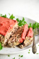 pressure cooker meatloaf recipe on a white plate with parsley