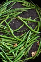 green beans cooked in a cast iron skillet with garlic
