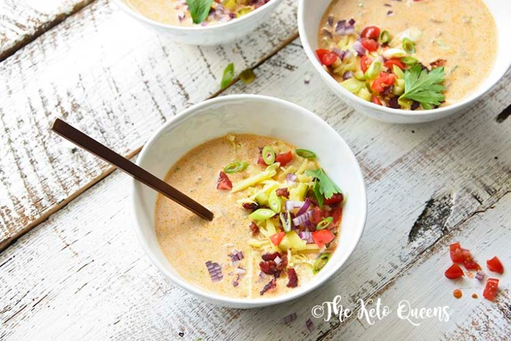 horizontal image of Keto Bacon Cheeseburger Soup with a spoon