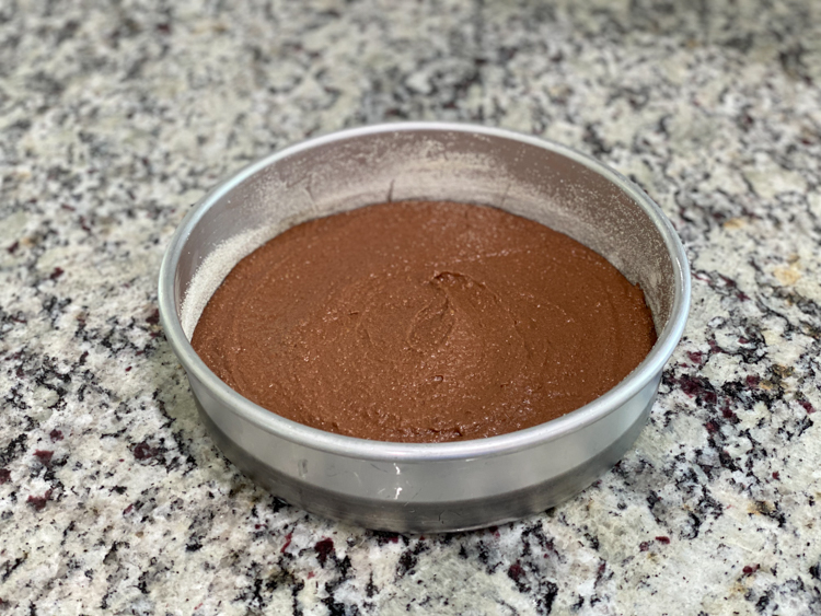 flourless cake batter in round pan