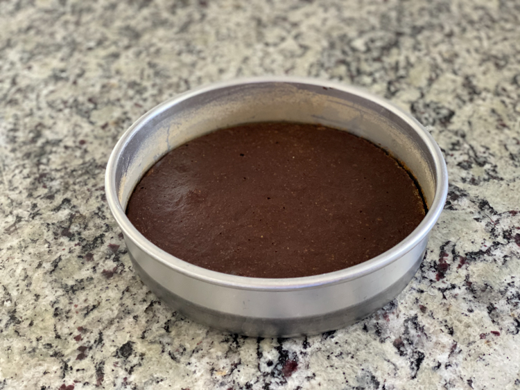 cooked flourless cake batter in round pan