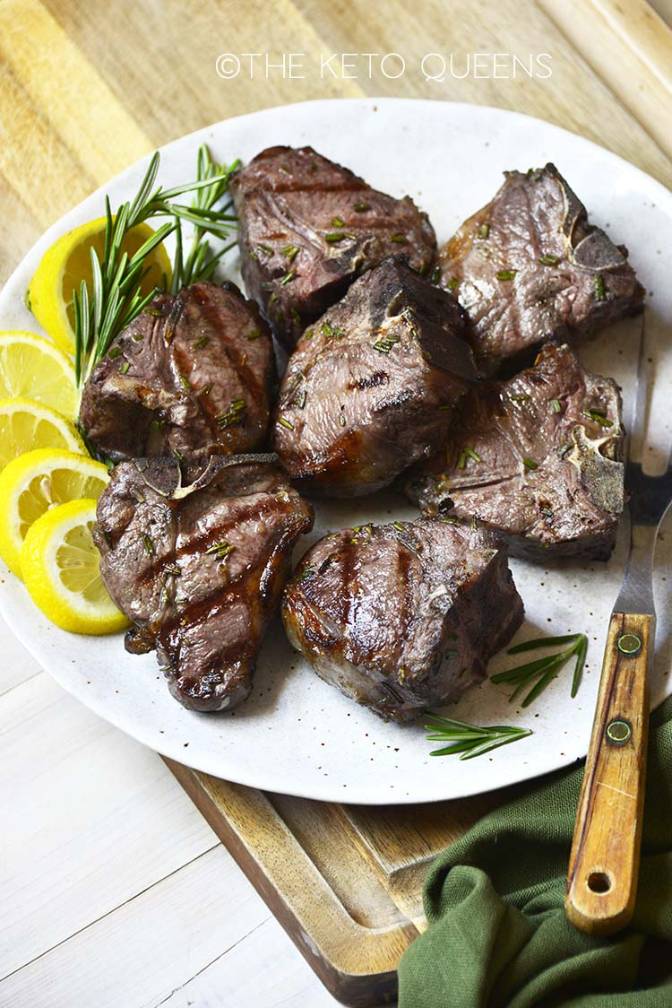 grilled lamb chops on white plate