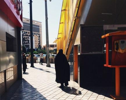 Woman passing by a bridge for crossing the main street near Imam Reza Shrine