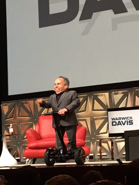 Warwick Davis on a Segway. Is he practicing to play a droid in Episode IX?