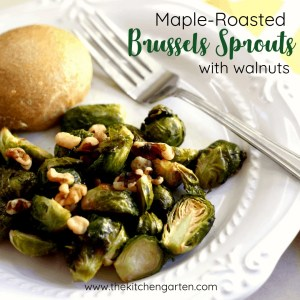 roasted brussels sprouts topped with walnuts on a white plate