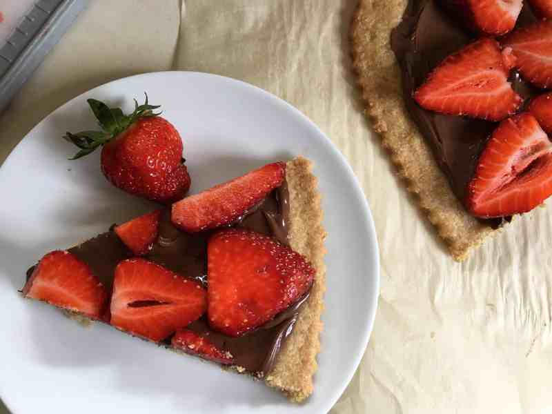 strawberry nutella tart slice on white plate